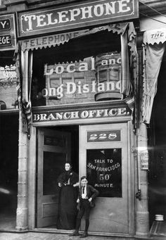 The first telephone pay station in Los Angeles, at 228 S. Spring Street, 1899. The service was not cheap: that 50¢ per minute call to San Francisco would cost $13.58 per minute in today's dollars.