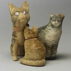 Three Cats, probably Germany and America, late 19th century, one gray tabby velour over papier-mache, glass eyes, mouth opens when head is pressed down, seated ht. 8 1/2; Art Fabric stuffed muslin gray tabby (stained), ht. 7; seated tan velvet cat, ht. 5 in.