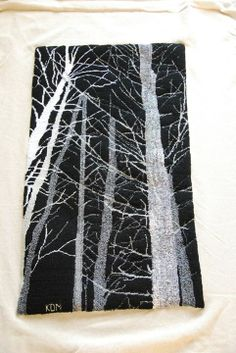 """""""Ghost Trees at Pog Lake, Algonquin Park,"""" designed and hand hooked with yarn by Karen Miller."""