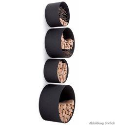 Kreisrunde Röhren bilden die Grundlage für dieses originelle Aufbewahrungssystem. Hier finden Feuerholz, Bücher und Wohnaccessoires bequem Platz. D...