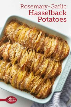 Rosemary-Garlic Hasselback Potatoes This impressive-but-easy dish will fill your kitchen with the enticing scents of rosemary and garlic. It's the perfect way to upgrade your potatoes! Expert tip: For quick slicing, a mandolin slicer can be used. Potato Side Dishes, Vegetable Dishes, Vegetable Recipes, Vegetarian Recipes, Cooking Recipes, Healthy Recipes, Quick Potato Recipes, Side Dishes For Fish, Side Dishes For Chicken