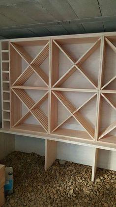 Casiers pour bouteilles, casier vin, cave à vin, rangement du vin, aménagement cave, casier bois, meuble en bois. Intégration de KR64 dans une structure bois pour un rangement optimisé.