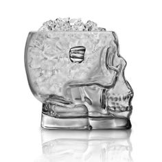 "Brainfreeze Glass Skull Ice Bucket - 54 oz by Final Touch. $26.95. Made of thick crystal clear glass with handles on each side.. Capacity: 54 oz.. Gives the beverage table at your party a little something different.. Dimensions: 7.5""W x 6""H x 6.7""D.. Great for Halloween parties or zombie film festivals.. Bring a dull party back from the dead with the elegant spookiness of the Brainfreeze Glass Skull Ice Bucket! Make the super thick, crystal-clear glass constructi..."