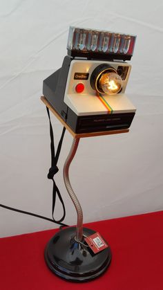 Nice little desk lamp made from a vintage Polaroid one step rainbow camera. c.1977 Requires candelabra bulb, included. Great gift for the camera collector or photographer. Please note this is a vintag