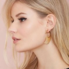 """741 wing and prayer tunnel Keep it fly in these gold earrings. They have a tunnel design with feather detailing. Rock them with a vintage tee and moto boots.  *3""""/7.5cm length  *Imported Nasty Gal Jewelry Earrings"""