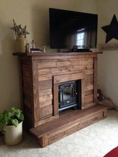 Image result for designing focal wall with electric stone fireplace and rustic shelves