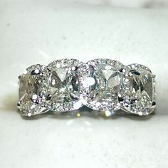 One Henri Daussi diamond wedding band set in 18K white gold
