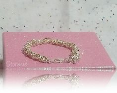 'Enchanting Angel Wings Intertwined Bracelet' is going up for auction at  9am Fri, Jul 26 with a starting bid of $3.