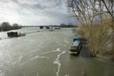 River Thames near Oxford in flood    posted by www.futons-direct.co.uk