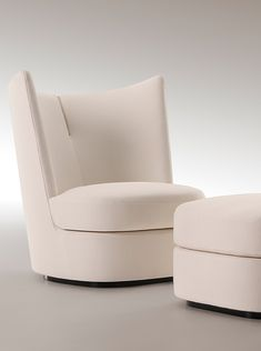 Something like this could work for next to your bed or even the living room. Contour armchair with ottoman | Paul Mathieu