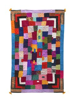 """AFRICAN QUILTS OF INDIA Small quilt. Tag reads: Name: Kitera Gustin Language: Konkani Village: Mainalli Length: 55"""" Width: 35"""" Sign: see product image"""