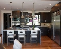 http://photo.foter.com/photos/pi/338/transitional-l-shaped-kitchen-designs-with-modern-kitchen-island-design-with-gray-marble-countertop-also-modern-white-bar-stool-with-back-also-brown-laminate-floor-and-unique-pendant-lights-l-shaped-k.jpg