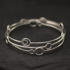 Sterling silver bangle bracelet set (three handmade bangles featuring a circle motif)