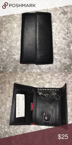 Timing Key Wallet NWT Key Wallet by Tumi. Simple luxury for keeping the keys in your life organized Tumi Bags