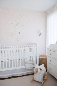 Neutral Nursery featuring sheep accents in this classic contemporary space!