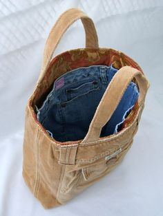 DIY! Turn two pairs of pants into a bag. Wooh!...and no need to sew pockets :)