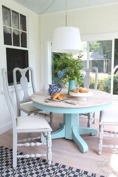 A sunroom furniture set makeover with a lovely table finished in a custom mix of Pure White and Provence Chalk Paint® decorative paint by Annie Sloan. A wash of Old White was applied to the top while the chairs received Paris Grey Painted Kitchen Tables, Dining Table Makeover, Kitchen Table Makeover, Dining Room Table, Wood Tables, Rustic Table, Patio Table, Dining Sets, Dining Chairs