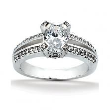 18k White Gold Oval Engagement Ring with Split Shank and Diamond Encrusted Head available at Wheat Jewelers