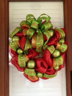 Christmas / Holiday Wreath with Merry Christmas Ribbon and Jingle Bell - Red Mesh Wreath. $80.00, via Etsy.