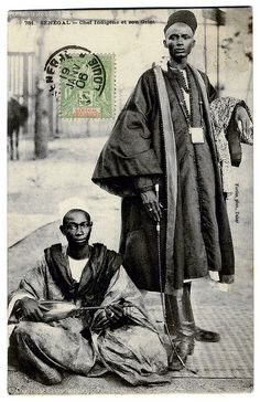 A Senegalese Chief and his Griot (c.1904)  Vintage photographic postcard, c.1904, circulated in 1906 from Saint-Louis (Senegal) to Toulouse (France), undivided back, published by the photographer Edmond Fortier, Dakar.