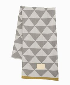 "#Ferm Living Shop — Remix (Gray) Blanket Ferm Living used its Remix print to make this gorgeous jacquard knit blanket. We suggest you throw it on your couch, put it on your bed or use it to stay warm on a cool night.  Dimensions: 47"" X 59"" Material: 100% Organic Cotton"