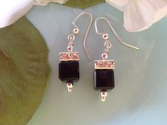 Check out this item in my Etsy shop https://www.etsy.com/listing/197774418/black-swarovski-earrings-bridal-earrings