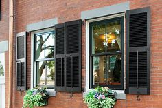 Use masonry anchors to attach working window coverings to a plain brick facade—and add some period charm, to boot Exterior Shutter Colors, Diy Exterior, Craftsman Exterior, Exterior House Colors, Exterior Paint, House Shutter Colors, Exterior Trim, Shutters Brick House, Window Shutters Exterior