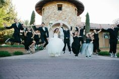 Jumping shot of bridal party to celebrate the marriage of the bride and groom | villasiena.cc