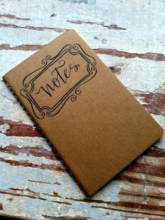 """Handwritten Calligraphy """"Notes"""" Journal with Decorative Border : Pocketsize Kraft Moleskine Notebook with Lined Pages. $12.00, via Etsy."""