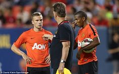 Making his point: Louis van Gaal (centre) makes his feelings known to Tom Cleverley (left)...