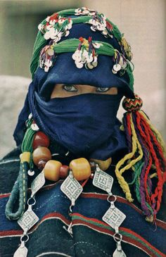 Moroccan woman of the Ait Hadiddou  Region, with layers of textiles and tribal jewelry. National Geographic | January 1980
