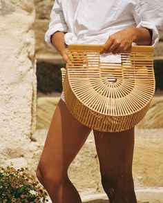 This summer's it bag can be traced back to a Japanese bamboo picnic bag from the 70s. LA label Cult Gaia has reproduced the classic half moon shaped tote into two sizes, both under $100. We love the bag for its unique shape and simple construction - it's perfect to take from the beach to an