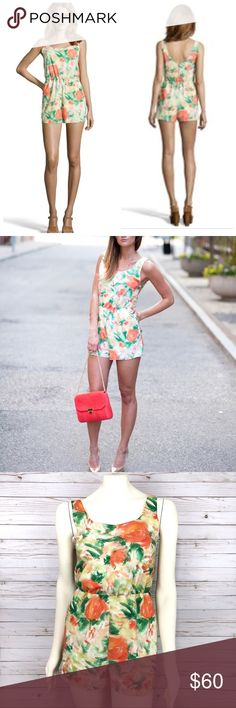 Alice + Olivia Naleigh floral romper/jumpsuit Alice + Olivia scoop Naleigh romper/jumpsuit  Abstract garden Abstract floral Orange & green Stretchy elastic waistband  Scoop neck Sleeveless  Side seam Pockets  Self & lining 97% polyester, 3% silk  Dry clean Alice + Olivia Pants Jumpsuits & Rompers