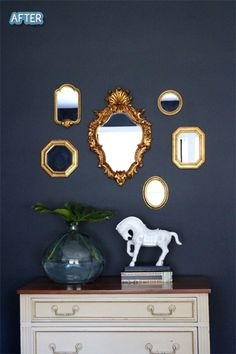 deep blue walls with cream furniture and gold mirrors