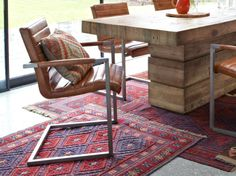 Santa Clara Sabina Dining Chair on a threadbare Oriental over concrete floor. Mmmm!