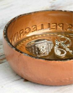 CUTE JEWELRY DISHES- Turn an old bottle into a place to display your favorite jewelry pieces.