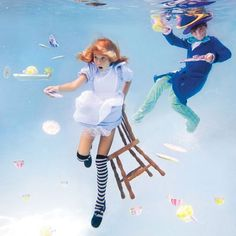 An expert underwater photographer, Elena Kalis's work has been featured in several publications and her artistic underwater photo's are simply lovely, armed with her underwater digital camera she took these amazing shots with a Alice in Wonderland design aesthetic, appropriately dubbed 'Alice in Water-land'
