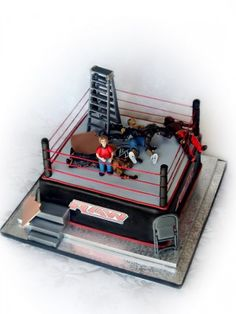 Top WWE Cakes don't hit me with a chair or ladder and don't put me through a table it looks tasty though