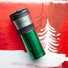 A double-walled, stainless steel tumbler with grippy center band and two-tone green finish.