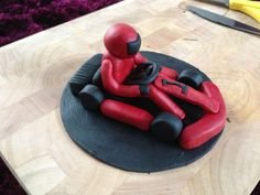 A go karting cake topper, perfect for a boy's birthday cake!