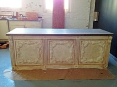 After I finish this row...Cash/Wrap counter, eight feet. Antique tin ceiling tiles, gray stained oak top