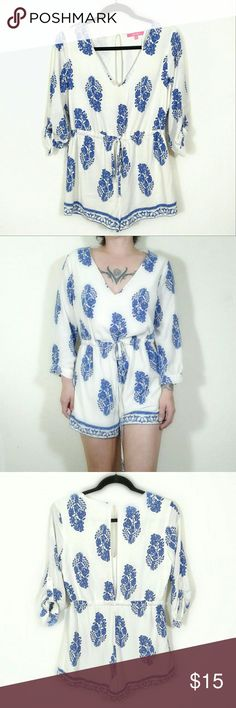 "NWOT Long-sleeve Boho print romper * Offers are awesome :) * Bundles make it better! NWOT X-Taren v-neck romper. White base color with blue India-chic floral print. Long sleeves with rollable button-up cuffs. Slit down back from one button at nape to waist. Has drawstring waist as well. Fully lined. 100% rayon.  - Size medium. Measurements laid flat:  Pit to pit 20""  Waist 12-17""  Inseam 2""  Total length 29"" #bohoromper #indiachic #playsuit #longsleeveromper Xtaren Pants Jumpsuits & Rompers"