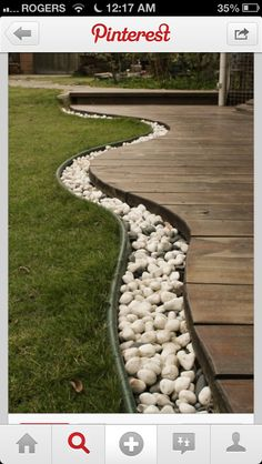 Rocks separate deck and grass. Add rope light for walk way