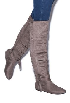 Revamp your flat boot collection with this fashionable and functional OTK. A slightly slouchy silhouette is offset with wraparound fringe detail, for the day-to-night style your closet's been craving.