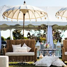 Tall umbrellas, large wicker chairs and wrought-iron tables for reception or cocktail area