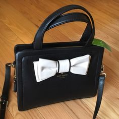 NEWKate Spade Dominique NEWKate Spade Dominique gorgeous Authentic  Kate Spade. Beautiful Black leather with pebble color bow.  Comes with removable Crossbody strapno tradeno holdno PayPal no lowball offers✅10% off bundles ✅SUBMIT REASONABLE OFFERS WITH OFFER BUTTON. I WILL NOT NEGOTIATE PRICES IN COMMENT SECTION kate spade Bags Satchels