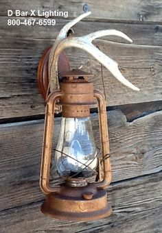 Rustic 15-inch lantern wall sconce light fixture with antler hook - Shown with old-fashioned rust finish