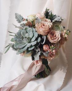 Vintage roses, succulent, dusty miller, ranunculus, garden spray roses