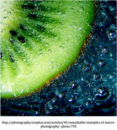 The piece of Kiwi fruit has been submerged in water giving the image a great amount of detail. The colour and contrast between the fruit and the background create a nice balance within the image.