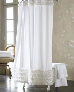 I saw one in a shop in Marietta, OH like this but with 12 rows of ruffles. I plan to make that one.  Ann Gish Ruffled Shower Curtain - Neiman Marcus